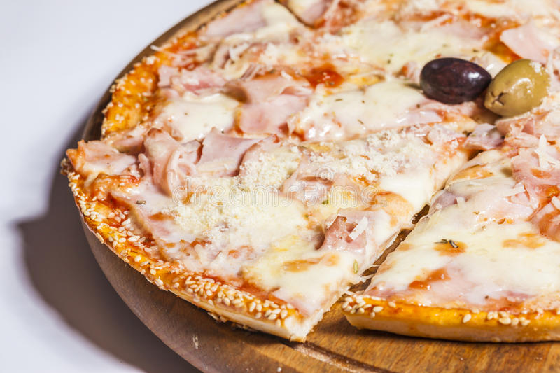 Tasty pizza on wooden board royalty free stock photos