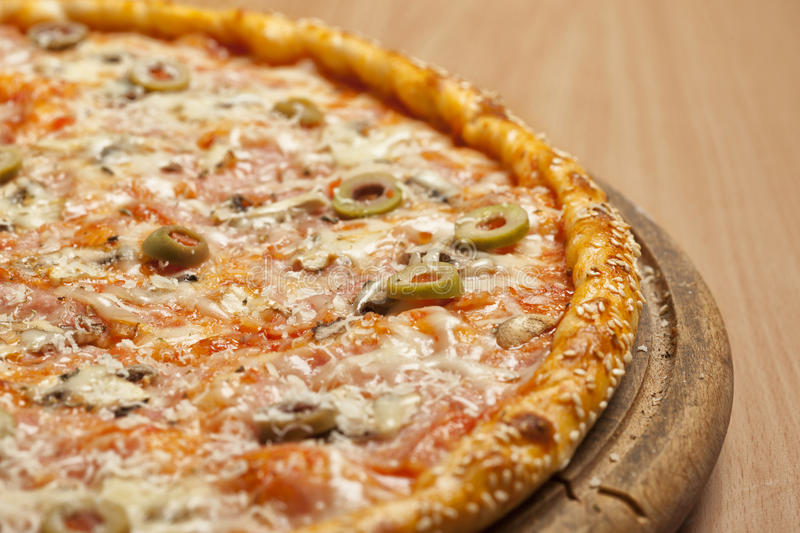 Tasty pizza on wooden board stock image