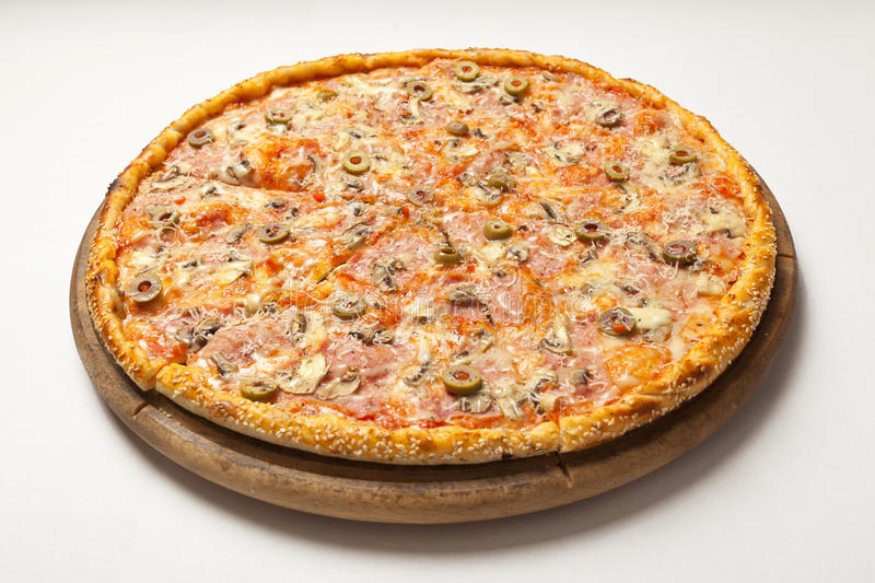 Tasty pizza on wooden board royalty free stock image