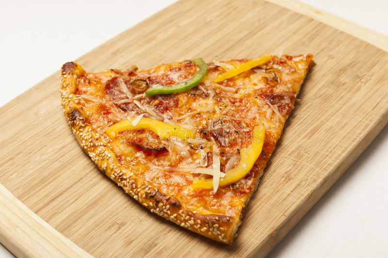 Tasty pizza on wooden board stock images