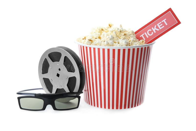 Tasty popcorn, ticket, glasses and movie reel. On white background royalty free stock photos