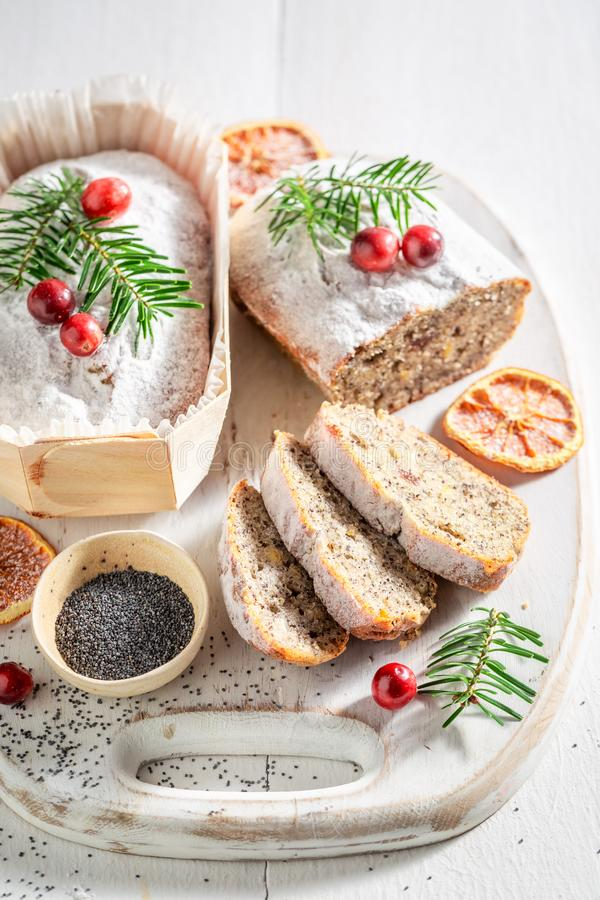 Tasty poppy seed cake for Christmas with orange and cranberry royalty free stock image
