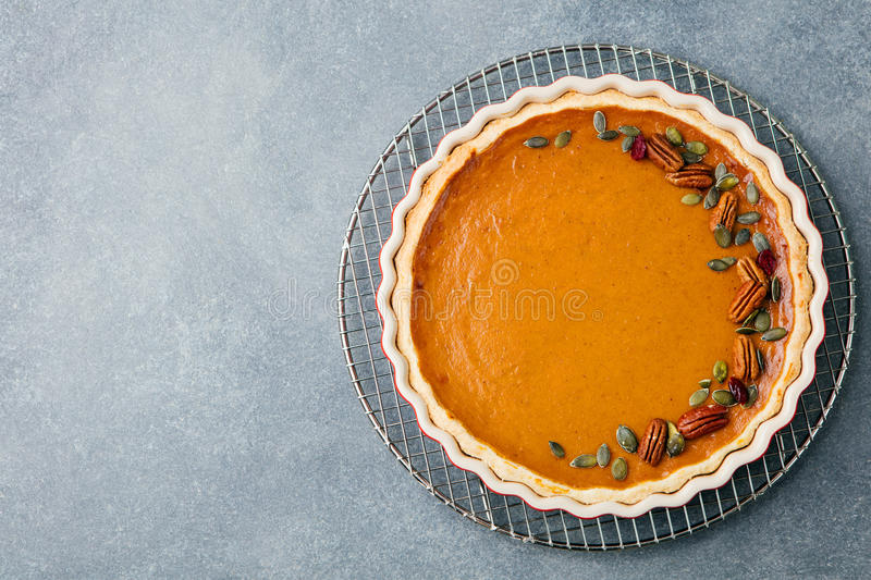 Tasty pumpkin pie, tart made for Thanksgiving day in a baking dish Top view Copy space royalty free stock image