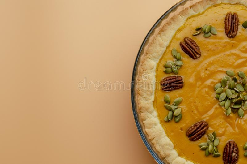 Tasty pumpkin pie, tart made for Thanksgiving day in a baking dish Top view royalty free stock photo