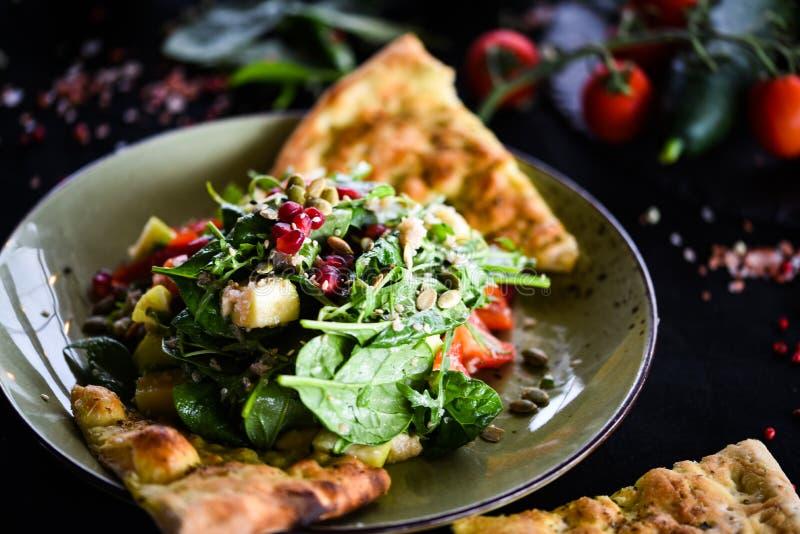 Tasty quinoa salad with fresh vegetables & focaccia bread stock image