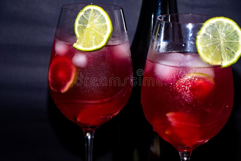 Tasty, red champagne in glasses. stock photos