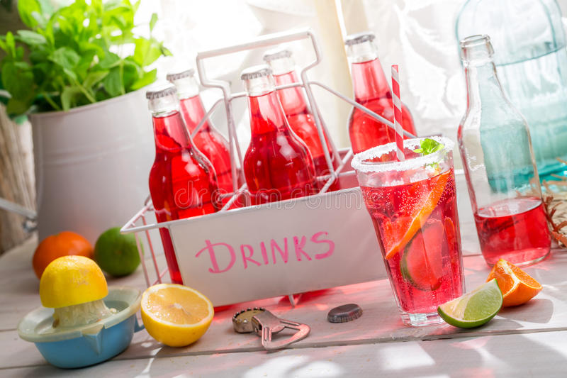 Tasty red orangeade with mint leaf royalty free stock photography