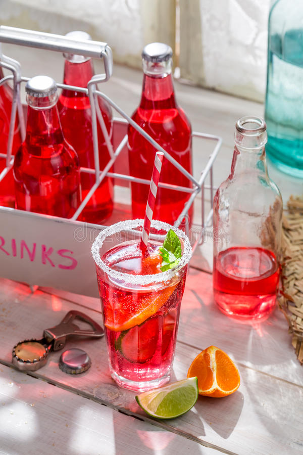 Tasty red summer drink with mint leaf stock photography