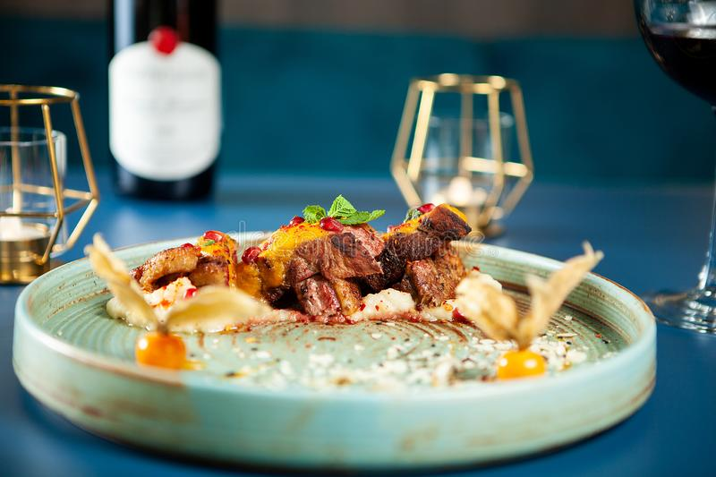 Tasty restaurant gastronomy with red wine on the table stock image