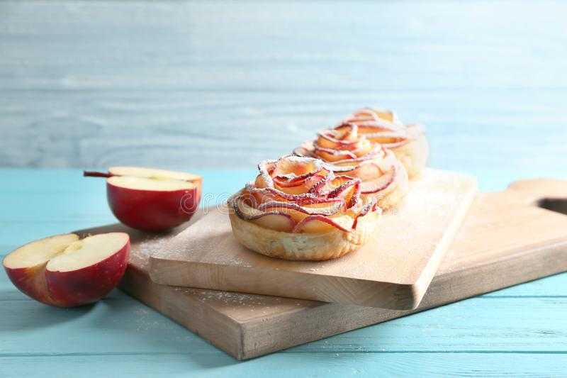 Tasty rose shaped apple pastry on wooden boards stock photo