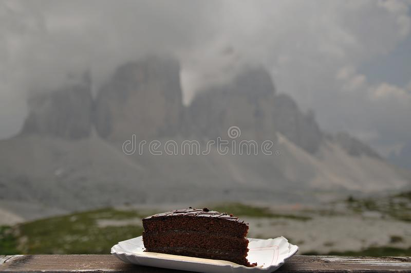 A tasty Sacker in front of the Tre cime di Lavaredo royalty free stock image