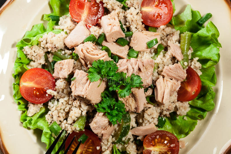 Tasty salad with couscous, tuna and vegetables royalty free stock photography