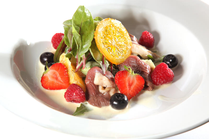 Tasty salad with fruits and meat stock photo