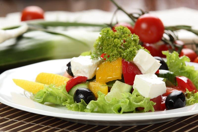 Tasty salad in white dish royalty free stock photos