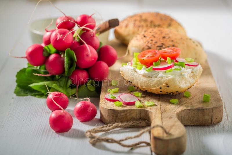 Tasty sandwich with crunchy bread, fromage cheese and radish. On white background royalty free stock photo