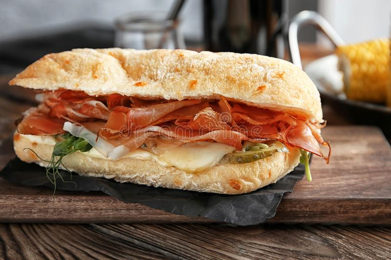 Tasty sandwich with prosciutto royalty free stock photos