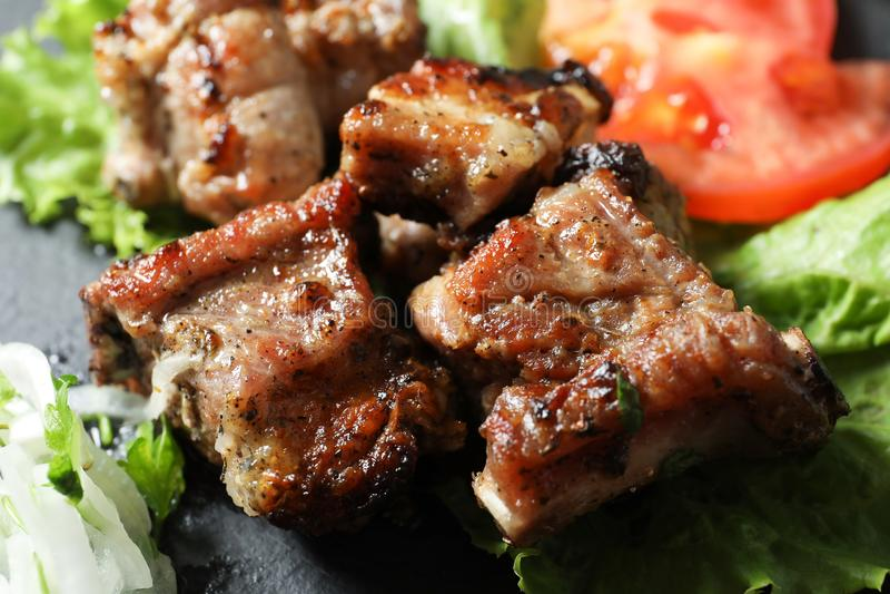 Tasty shish kebab served on slate plate. Closeup royalty free stock image