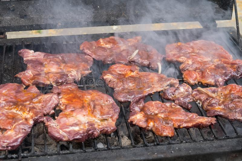 Tasty steaks on barbecue. Meat during grilling. Steaks on barbecue. Meat during grilling stock photos
