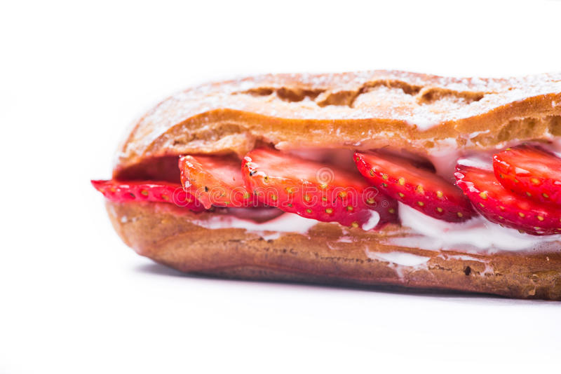 Tasty strawberry cake eclair isolated royalty free stock image