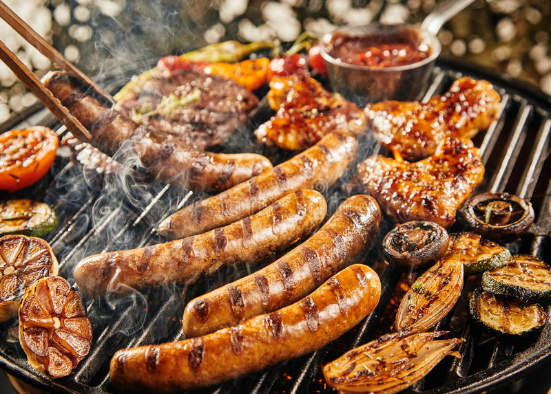 Tasty summer picnic with grilling food on a BBQ stock photography