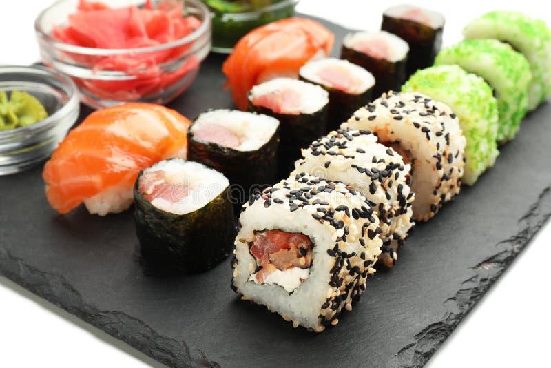 Tasty sushi on slate plate royalty free stock images