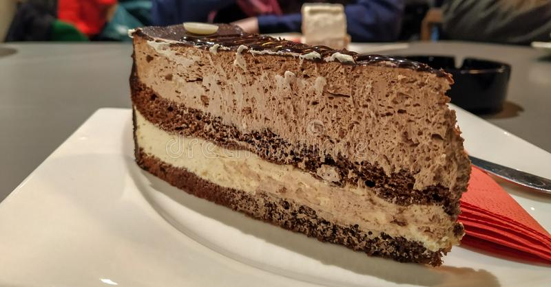 Tasty sweet cake chocolate dessert served on plate in restaurant as caloric cheat meal royalty free stock photography