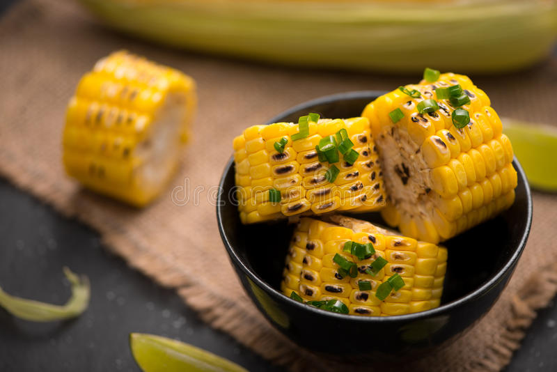 Tasty sweet grilled corn with onion sauce royalty free stock photography