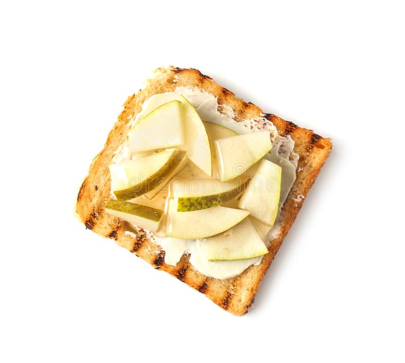 Tasty sweet toast with butter, honey and pieces of pear on white background royalty free stock images