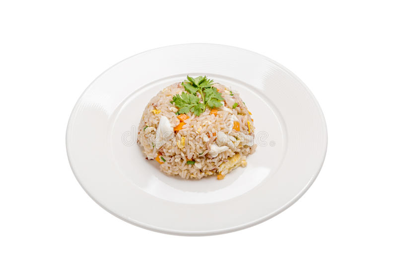 Tasty Thai cuisine, crab meat fried rice beautiful serving in white plate isolated on white background. royalty free stock images