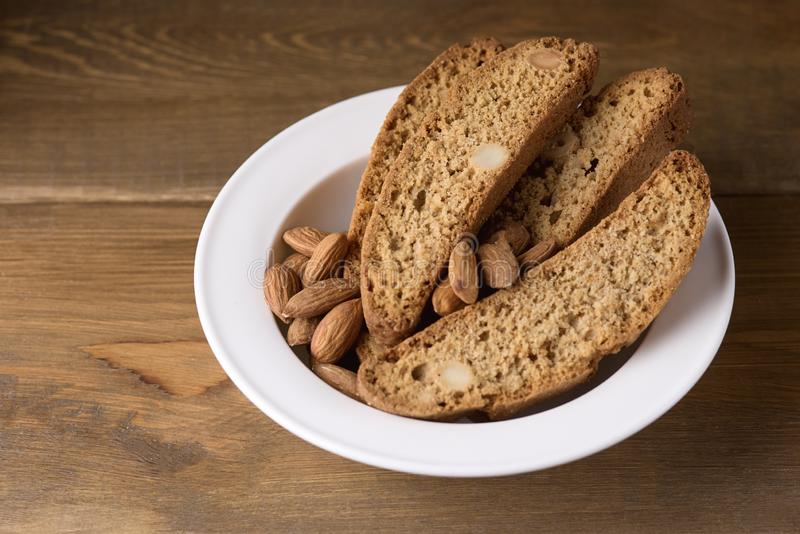 Tasty Traditional Italian Sweets Biscotti or Cantucci on White Plate Wooden Background Italian Biscotti for Coffee or Wine Italian. Snack stock photos