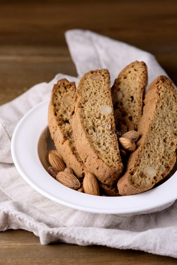Tasty Traditional Italian Sweets Biscotti or Cantucci on White Plate Wooden Background Italian Biscotti for Coffee or Wine Italian. Snack stock image