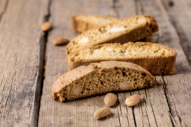 Tasty Traditional Italian Sweets Biscotti or Cantucci on Wooden Background Italian Biscotti for Coffee or Wine Italian Snack. Horizontal royalty free stock photos