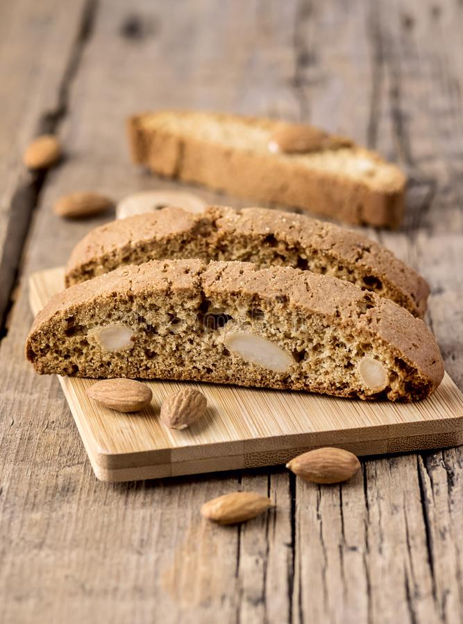Tasty Traditional Italian Sweets Biscotti or Cantucci on Wooden Background Italian Biscotti for Coffee or Wine Italian Snack. Vertical royalty free stock image