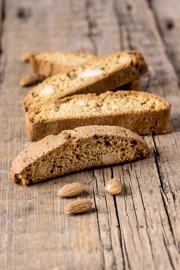 Tasty Traditional Italian Sweets Biscotti or Cantucci on Wooden Background Italian Biscotti for Coffee or Wine Italian Snack. Vertical stock photos