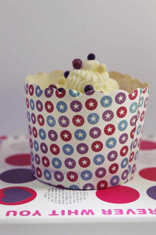 Tasty vanilla cupcake on a stand royalty free stock image