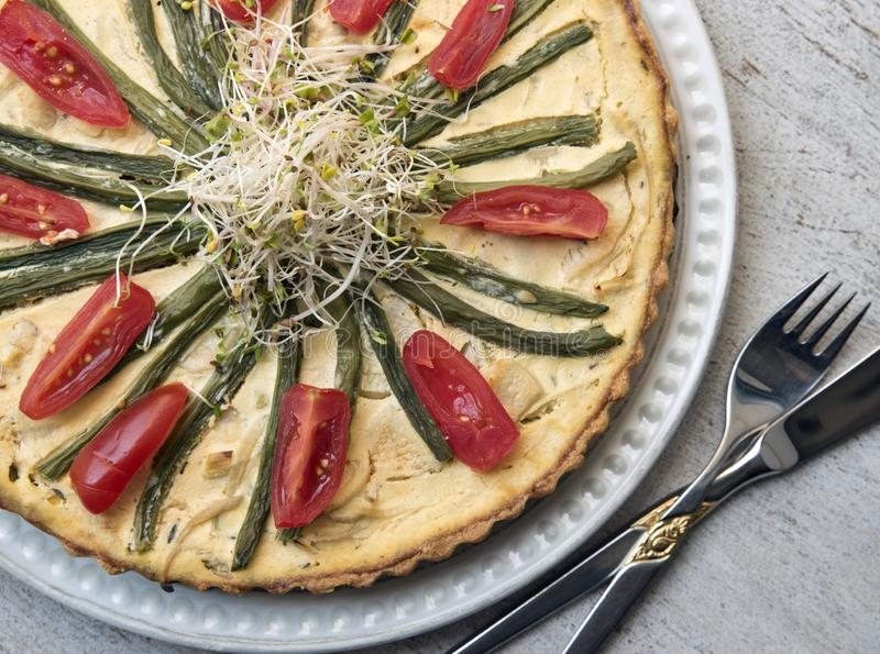 Tasty vegetable tart on vintage background. Healthy food. Vegetarianism royalty free stock image
