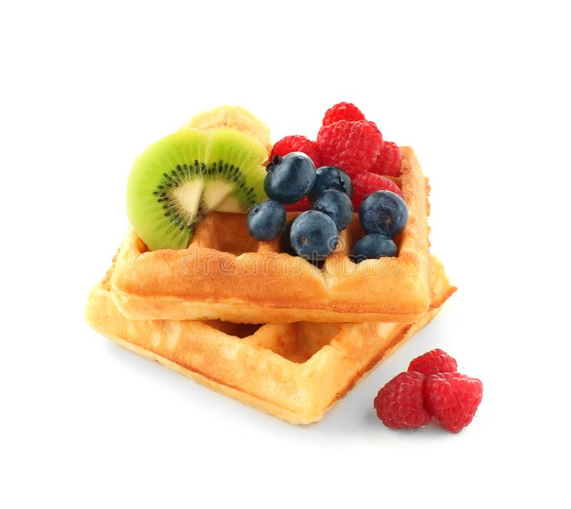 Tasty waffles with fruits and berries on white background royalty free stock photos