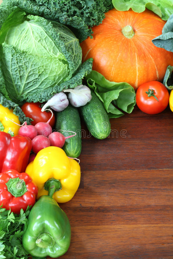 Tasty wallpaper. Wallpaper with appetizing fresh vegetables and fruits stock images