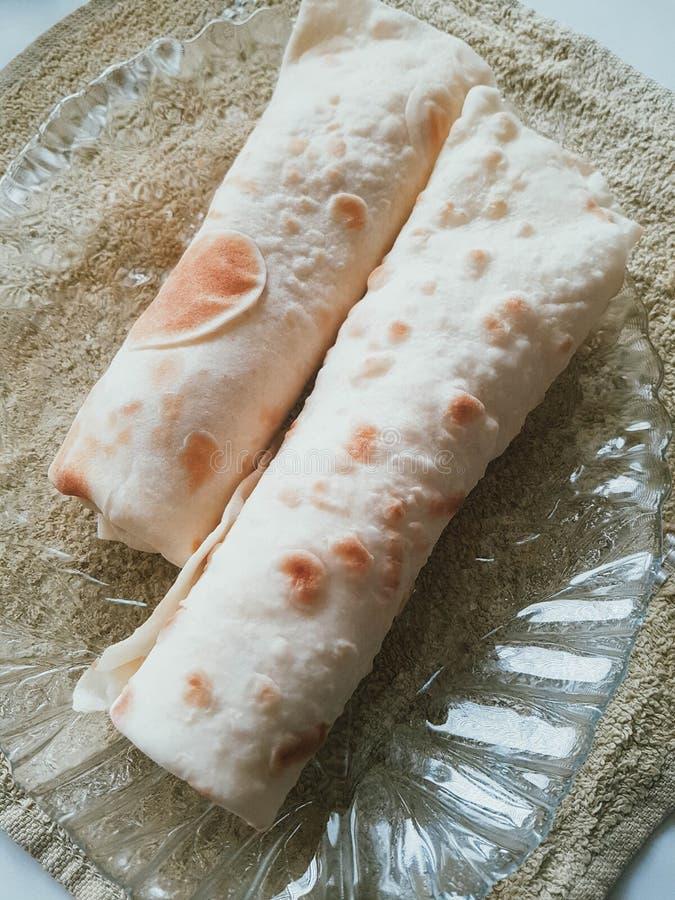 Tasty wrapped burrito. Delicious trditional latin cousine stock photos