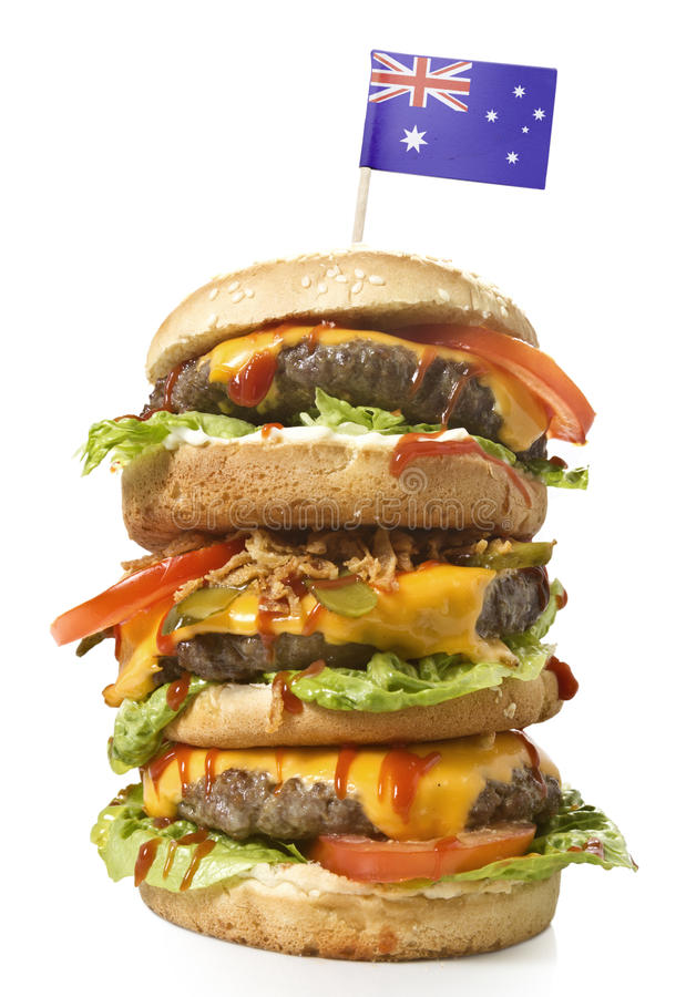 Tasty XXL Hamburger with the flag of Australia.series royalty free stock photo