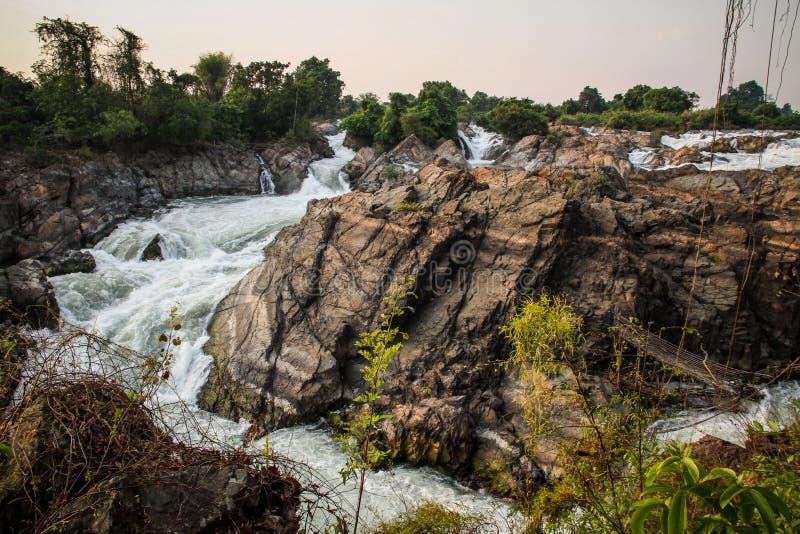 Tat Somphamit Waterfall al tramonto, Don Khon, si Phan Don, provincia di Champasak, Laos fotografia stock libera da diritti