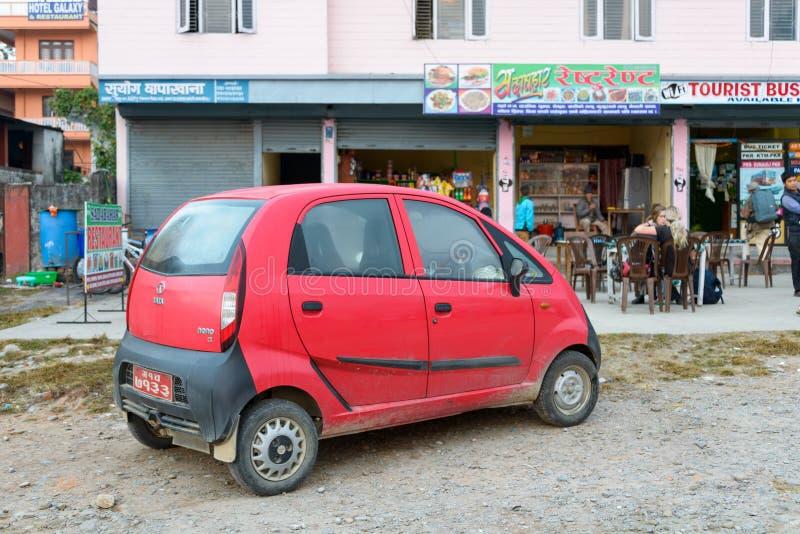 Tata Nano rossa immagini stock libere da diritti