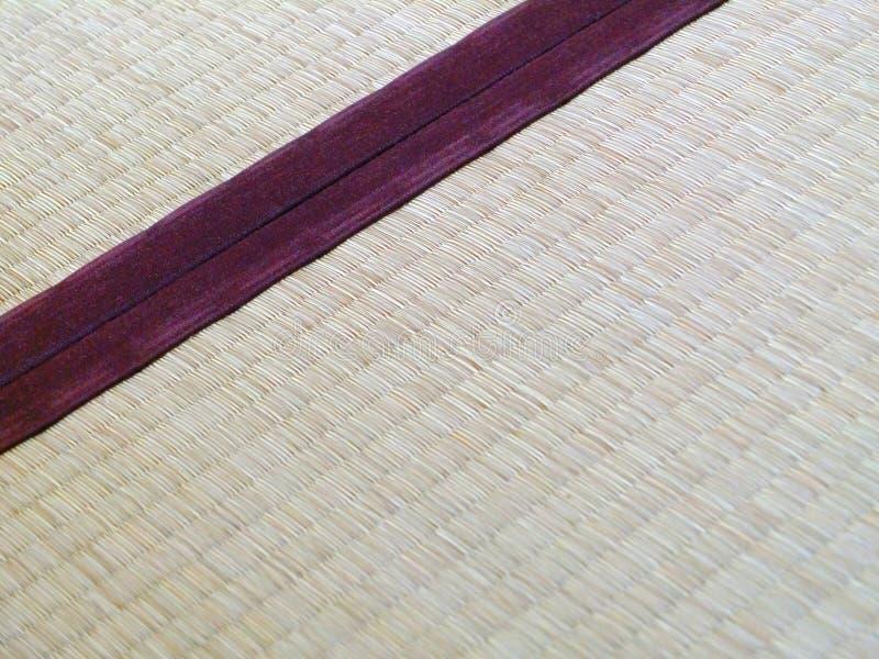 Tatami mat closeup with violet edging (heri). Straws visible stock photo