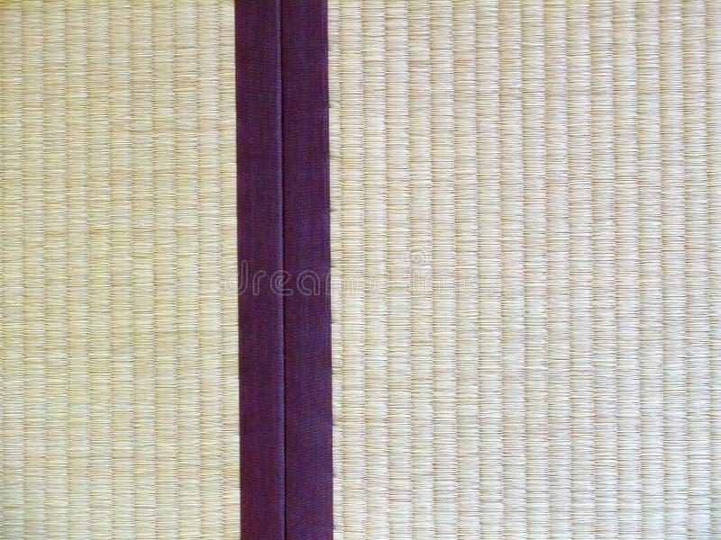 Tatami mat closeup with violet edging (heri). Straws visible stock photography