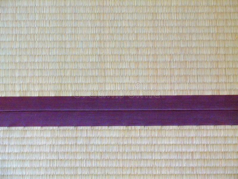 Tatami mat closeup with violet edging (heri). Straws visible stock photos