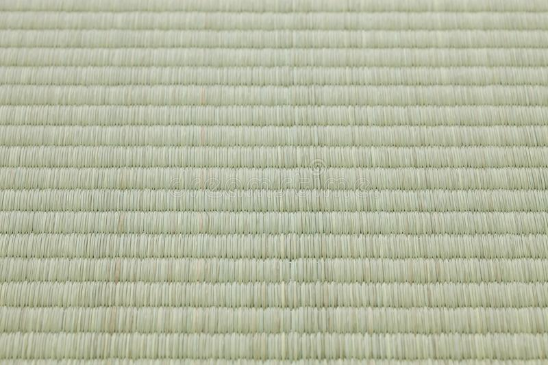 Tatami mat, flooring materieal in traditional Japanese style rooms. A tatami is a type of mat used as a flooring material in traditional Japanese style rooms stock photography