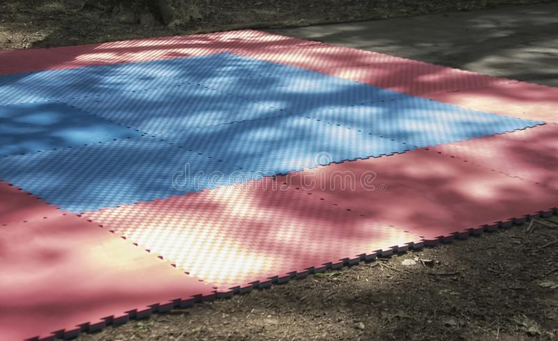 Tatami Mat. A partial view of a tatami mat for martial arts outdoors royalty free stock image