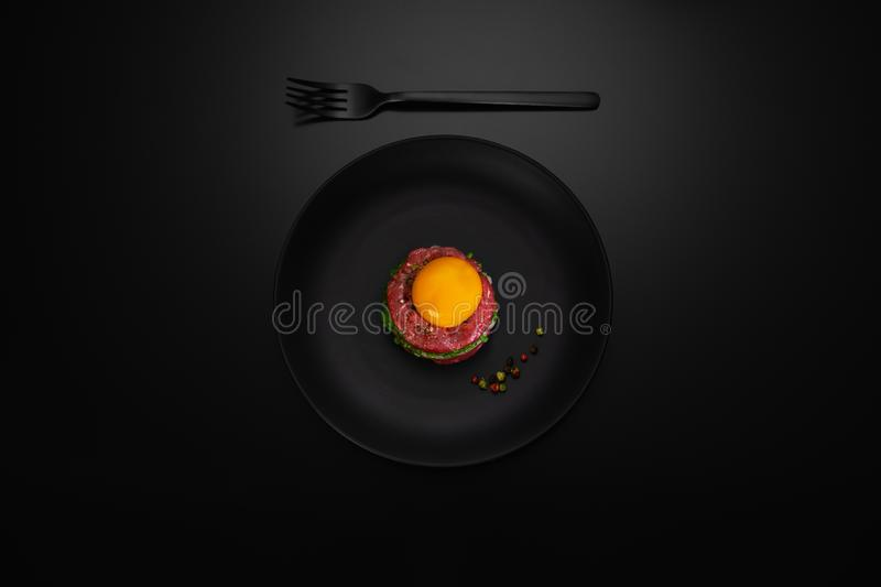 tartar beef meat on a plate stock photo