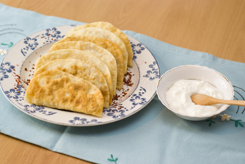 The Tatar meal, pies fried with forcemeat yogurt. royalty free stock photography