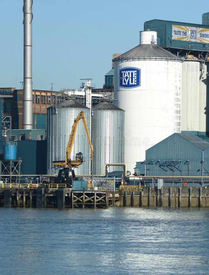 Tate & Lyle riverside sugar Refinery. River Thames. Tate & Lyle PLC is a British-headquartered, global supplier of food and beverage ingredients to industrial stock photography